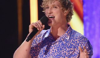 FILE - In this Aug. 13, 2017 file photo, Logan Paul speaks at the Teen Choice Awards at the Galen Center in Los Angeles. YouTube has temporarily suspended all ads from Paul's channels after what it calls a pattern of behavior unsuitable for advertisers. An email sent to Paul's merchandise company for comment was not immediately answered Friday, Feb. 9, 2018. (Photo by Phil McCarten/Invision/AP, File)