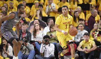 Maryland guard Anthony Cowan (1) dribbles the ball against Northwestern forward Vic Law (4) during the first half of an NCAA basketball game, Saturday, Feb. 10, 2018, in College Park, Md. (AP Photo/Nick Wass) **FILE**