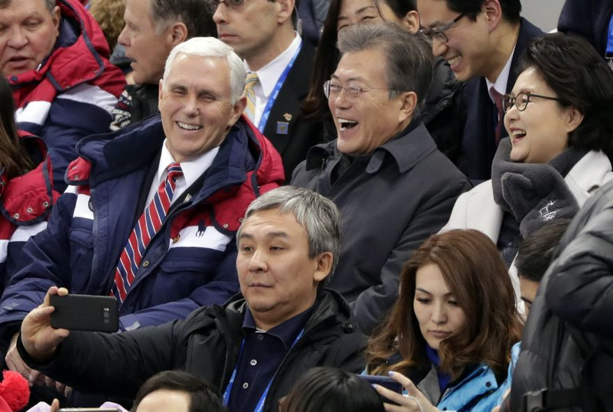 United States' Vice President Mike Pence and South Korean President Moon Jae-in laugh during the ladies' 500 meters short-track speedskating in the Gangneung Ice Arena at the 2018 Winter Olympics in Gangneung, South Korea, Saturday, Feb. 10, 2018. (AP Photo/Julie Jacobson)