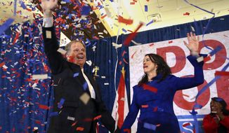 FILE- This Dec. 12, 2017 file photo shows Democratic candidate for U.S. Senate Doug Jones and his wife Louise wave to supporters before speaking Tuesday, Dec. 12, 2017, in Birmingham, Ala. Jones defeated Republican Roy Moore. Fresh off U.S. Sen. Doug Jones' history-making upset over Republican Roy Moore, Alabama Democrats have found something they lacked for a long time: Hope. (AP Photo/John Bazemore, File)