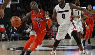 Auburn guard Jared Harper (1) drives against Georgia guard William Jackson II (0) in the first half of an NCAA college basketball game, Saturday, Feb. 10, 2018, in Athens, Ga. (AP Photo/John Bazemore)
