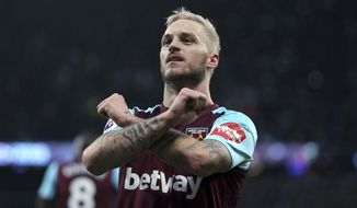 West Ham United's Marko Arnautovic celebrates scoring the second goal of the game during the English Premier League soccer match between West Ham United and Watford at the London Stadium, London, England. Saturday Feb. 10, 2018. (Steven Paston/PA via AP)