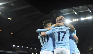 Manchester City's Sergio Aguero, left, celebrates with his teammates after scoring his side's second goal during the English Premier League soccer match between Manchester City and Leicester City at the Etihad Stadium in Manchester, England, Saturday, Feb. 10, 2018. (AP Photo/Rui Vieira)