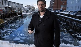 "In this Thursday, Feb. 8, 2018 photo Jeremy DaRos, who received an erroneous tsunami alert on his phone, poses on the waterfront in Portland, Maine. ""People need to trust the alerts they're pushing out,"" he said. ""This is important stuff, and to have two incidents in the span of a month is just unacceptable."" (AP Photo/Robert F. Bukaty)"