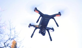 A 3DR surveillance drone flies above a prescribed burn area in the Kenai National Wildlife Refuge in Sterling, Alaska, Feb. 1, 2018. (Erin Thompson/Peninsula Clarion via AP) ** FILE **