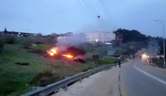 """In this image made from video provided by Yehunda Pinto, the wreckage of a jet is seen on fire near Harduf, northern Israel, Saturday, Feb. 10, 2018. The Israeli military shot down an Iranian drone that infiltrated the country early Saturday before launching a """"large-scale attack"""" on at least a dozen Iranian and Syrian targets in Syria. Israel called it a """"severe and irregular violation of Israeli sovereignty"""" and warned of further action against the unprecedented Iranian aggression. (Yehunda Pinto via AP)"""