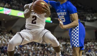 Texas A&M guard TJ Starks (2) goes around Kentucky forward PJ Washington (25) for a basket during the first half of an NCAA college basketball game Saturday, Feb. 10, 2018, in College Station, Texas. (AP Photo/Sam Craft)
