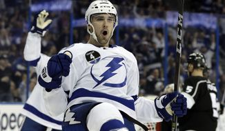 Tampa Bay Lightning center Cedric Paquette (13) celebrates after scoring against the Los Angeles Kings during the second period of an NHL hockey game Saturday, Feb. 10, 2018, in Tampa, Fla. (AP Photo/Chris O'Meara)