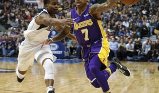 Los Angeles Lakers guard Isaiah Thomas (7) loses the ball as he drives to the basket against Dallas Mavericks guard Yogi Ferrell (11) during an NBA basketball game in Dallas, Saturday, Feb. 10, 2018. (AP Photo/ Richard W. Rodriguez)