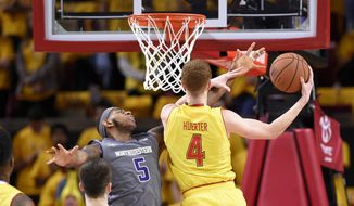 Maryland guard Kevin Huerter (4) goes to the basket against Northwestern center Dererk Pardon (5) during the first half of an NCAA basketball game, Saturday, Feb. 10, 2018, in College Park, Md. (AP Photo/Nick Wass)