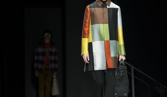 A model wears fashion from the Bottega Veneta collection during Fashion Week in New York, Friday, Feb. 9, 2018. (AP Photo/Craig Ruttle)