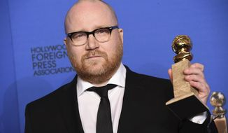 "FILE - In this Jan. 11, 2015 file photo, Johann Johannsson poses in the press room with the award for best original score for ""The Theory of Everything"" at the 72nd annual Golden Globe Awards at the Beverly Hilton Hotel in Beverly Hills, Calif. The award-winning musician and film composer has died according to his manager, Tim Husom.  Husom says Johannsson died Friday, Feb. 9, 2018 in Berlin.   ( Photo by Jordan Strauss/Invision/AP, File)"