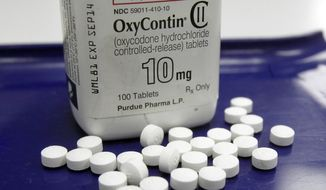 This Feb. 19, 2013 file photo shows OxyContin pills arranged for a photo at a pharmacy in Montpelier, Vt.   (AP Photo/Toby Talbot, File) **FILE**