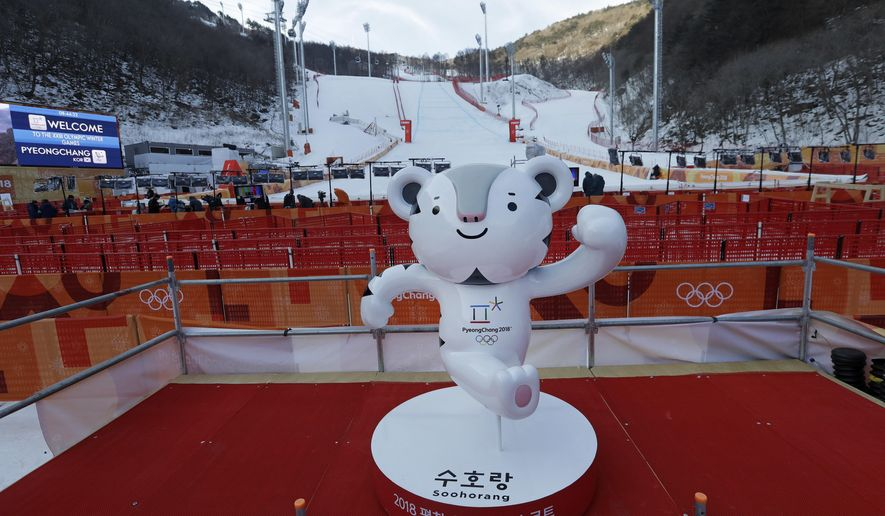 A games mascot stands alone in a deserted finish area after the men's downhill was postponed due to high winds at the 2018 Winter Olympics in Jeongseon, South Korea, Sunday, Feb. 11, 2018. (AP Photo/Luca Bruno)