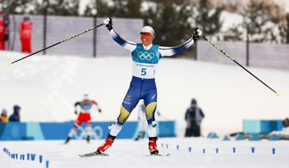 Charlotte Kalla, of Sweden, celebrates after winning the women's 7.5km /7.5km skiathlon cross-country skiing competition at the 2018 Winter Olympics in Pyeongchang, South Korea, Saturday, Feb. 10, 2018. (AP Photo/Matthias Schrader)