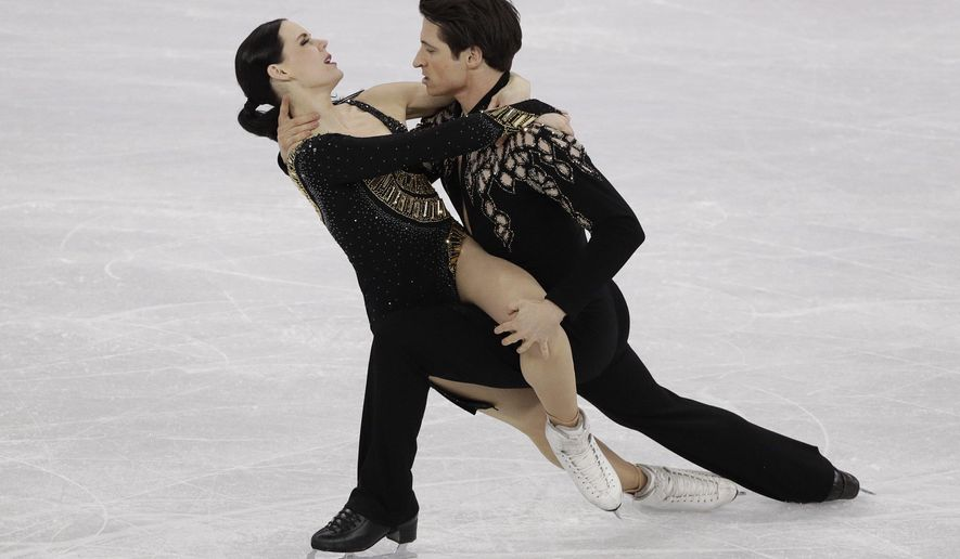 Tessa Virtue and Scott Moir of Canada perform during the ice dance short dance team event in the Gangneung Ice Arena at the 2018 Winter Olympics in Gangneung, South Korea, Sunday, Feb. 11, 2018. (AP Photo/David J. Phillip)