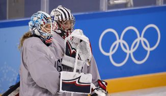FILE - In this Feb. 4, 2018, file photo, United States goalies Alex Rigsby, left, and Nicole Hensley chat during a training session prior to the 2018 Winter Olympics in Gangneung, South Korea. Robb Stauber knows who he plans to start in net when the Americans kick off their quest for Olympic gold. The U.S. coach simply chooses not to share that information just yet. Not that waiting to hear who gets the honor of playing Sunday, Feb. 11, against Finland is bothering Maddie Rooney, Rigsby or Hensley. (AP Photo/Jae C. Hong, File)