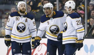 Buffalo Sabres' Evander Kane (9) celebrates his goal with teammates Ryan O'Reilly (90) and Sam Reinhart (23) during the second period of an NHL hockey game against the Boston Bruins in Boston, Saturday, Feb. 10, 2018. (AP Photo/Michael Dwyer)