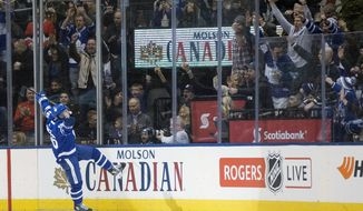 Toronto Maple Leafs' Mitchell Marner celebrates his goal against the Ottawa Senators during the first period of an NHL hockey game, Saturday, Feb. 10, 2018, in Toronto. (Chris Young/The Canadian Press via AP)