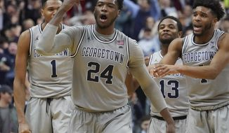 Georgetown forward Marcus Derrickson (24) reacts to hitting a 3-pointer to give Georgetown the lead in the final minute of an NCAA college basketball game against Seton Hall on Saturday, Feb. 10, 2018, in Washington. Celebrating with Derrickson are his Jamorko Pickett (1), Trey Dickerson (13), and Jagan Mosely (4), Georgetown won 83-80. (AP Photo/Pablo Martinez Monsivais)