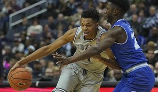 Georgetown forward Jamorko Pickett (1) goes up against Seton Hall guard Myles Cale (22) during the first half of an NCAA college basketball game, on Saturday, Feb. 10, 2018, in Washington. (AP Photo/Pablo Martinez Monsivais)