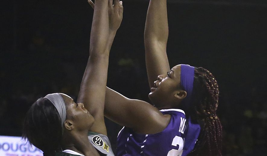 TCU center Jordan Moore, right, shoots over Baylor center Kalani Brown during the first half of an NCAA college basketball game Saturday, Feb. 10, 2018, in Waco, Texas. (AP Photo/Jerry Larson)