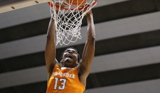 Tennessee guard Jalen Johnson dunks against Alabama during the first half of an NCAA college basketball game Saturday, Feb. 10, 2018, in Tuscaloosa, Ala. (AP Photo/Brynn Anderson)