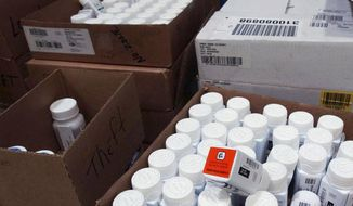 FILE - In this Sept. 1, 2004, file photo, medical bottles bearing tracking codes in the McKesson medical distribution center in Delran, N.J. President Donald Trump has made big promises to reduce prescription drug costs, but his administration is gravitating to relatively modest steps such as letting Medicare patients share in manufacturer rebates. (AP Photo/Brian Branch-Price, File)
