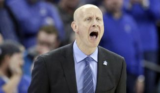 Xavier coach Chris Mack yells instructions during the second half of an NCAA college basketball game against Creighton in Omaha, Neb., Saturday, Feb. 10, 2018. Xavier won 72-71. (AP Photo/Nati Harnik)