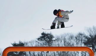 American Red Gerard jumps during the men's slopestyle final at Phoenix Snow Park at the Winter Olympics in Pyeongchang, South Korea, on Sunday. Gerard won gold for the U.S. (ASSOCIATED PRESS PHOTOGRAPHS)
