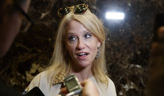 Kellyanne Conway, then-campaign manager for President-elect Donald Trump, talks with reporters as she arrives at Trump Tower, Monday, Nov. 14, 2016, in New York. (AP Photo/ Evan Vucci) ** FILE **