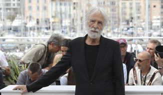 Director Michael Haneke poses for photographers during the photo call for the film Happy End at the 70th international film festival, Cannes, southern France, Monday, May 22, 2017. (AP Photo/Alastair Grant)