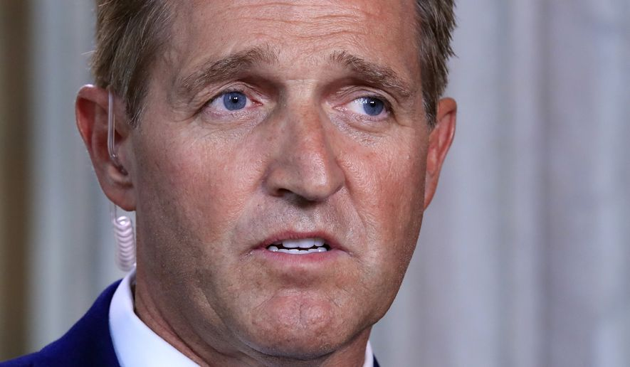 "Sen. Jeff Flake, R-Ariz., speaks during a television interview Capitol Hill in Washington, Tuesday, Oct. 24, 2017. Sen. Flake, an Arizona Republican, announced he would not run for re-election in 2018, condemning in a speech aimed at President Donald Trump the ""flagrant disregard of truth and decency"" that is undermining American democracy. (AP Photo/Manuel Balce Ceneta)"