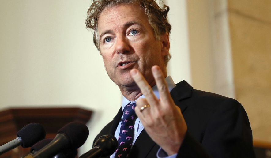 In this Sept. 25, 2017, file photo, Sen. Rand Paul, R-Ky., speaks during a news conference on Capitol Hill in Washington. Rene Boucher, the man accused of tackling U.S. Sen. Rand Paul in the Kentucky lawmaker's yard has been charged with assaulting a member of Congress as part of a federal plea agreement. And his lawyer confirmed what's long been suggested by neighbors: The attack stemmed from a dispute about yard maintenance. (AP Photo/Pablo Martinez Monsivais, File)