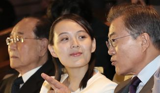 South Koran President Moon Jae-in talks with Kim Yo-jong, North Korean leader Kim Jong-un's sister, during a performance of North Korea's Samjiyon Orchestra at National Theater in Seoul, South Korea, Sunday, Feb. 11, 2018. At left is North Korea's nominal head of state Kim Yong-nam. (Bee Jae-man/Yonhap via AP)