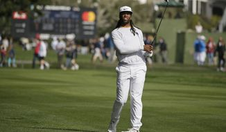 Larry Fitzgerald follows his shot from the 16th fairway of the Pebble Beach Golf Links during the final round of the AT&T Pebble Beach National Pro-Am golf tournament Sunday, Feb. 11, 2018, in Pebble Beach, Calif. (AP Photo/Eric Risberg)