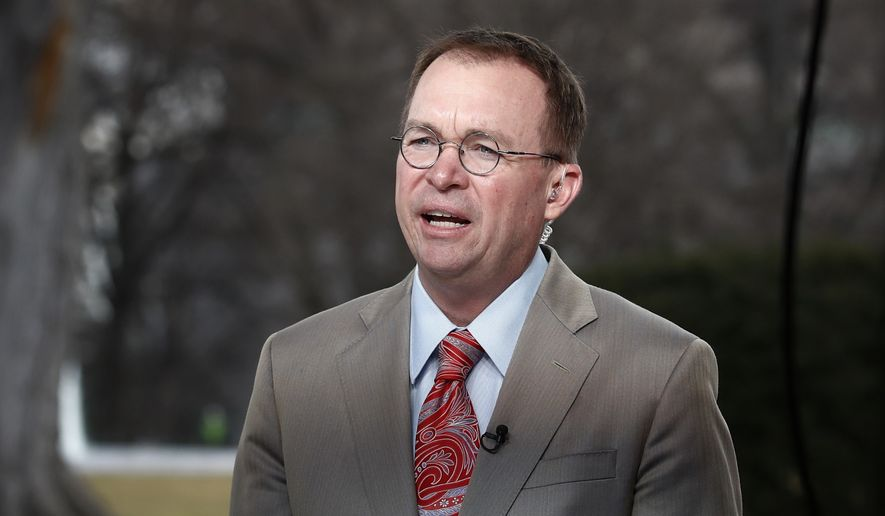 This Jan. 22, 2018, file photo shows Director of the Office of Management and Budget Mick Mulvaney talking during a television interview outside the White House in Washington. (AP Photo/Carolyn Kaster, File)