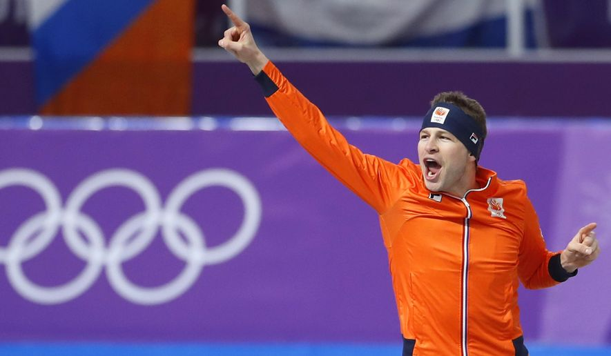 Gold medallist Sven Kramer of The Netherlands celebrates setting a new Olympic record during the men's 5,000 meters race at the Gangneung Oval at the 2018 Winter Olympics in Gangneung, South Korea, Sunday, Feb. 11, 2018. (AP Photo/Petr David Josek)