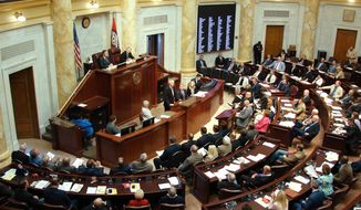 FILE - In this May 1, 2017, file photo, Gov. Asa Hutchinson speaks to the Arkansas Legislature in Little Rock, Ark. Lawmakers will return to the Capitol on Monday, Feb. 12, 2018, to set the state's funding plan for a fiscal year starting in July. (AP Photo/Kelly P. Kissel, File)