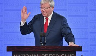 Former Australian Prime Minister Kevin Rudd speaks at the National Press Club in Canberra, Monday, Feb. 12, 2018. Rudd committed Australia to reducing the difference in life expectancies between Aboriginal and non-indigenous people on Feb. 13, 2008, when he made a historic apology to Australia's indigenous minority for past injustices. Rudd told the National Press Club of Australia on Monday that the conservative governments of Prime Minister Malcolm Turnbull and his predecessor Tony Abbott had failed to maintain funding for overcoming disadvantage. (Mick Tsikas/AAP Image via AP)