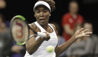 USA's Venus Williams returns a shot against Netherlands' Richel Hogenkamp during a match in the first round of Fed Cup tennis competition in Asheville, N.C., Sunday, Feb. 11, 2018. (AP Photo/Chuck Burton)