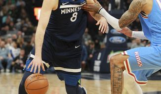 Minnesota Timberwolves forward Nemanja Bjelica (8) drives against Sacramento Kings forward Willie Cauley-Stein (00) in the second quarter of an NBA basketball game Sunday, Feb, 11, 2018, in Minneapolis. (AP Photo/Andy Clayton-King)