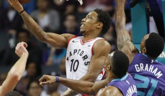 Toronto Raptors guard DeMar DeRozan (10) shoots against the Charlotte Hornets in the first half of an NBA basketball game in Charlotte, N.C., on Sunday, Feb. 11, 2018. (AP Photo/Nell Redmond)
