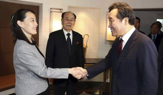"Kim Yo Jong, left, sister of North Korean leader Kim Jong Un, shakes hands with South Korean Prime Minister Lee Nak-yeon as Kim Yong Nam, center, North Korea's nominal head of state, watches during a luncheon in Seoul, South Korea, Sunday, Feb. 11, 2018. A rare invitation to Pyongyang for South Korea's president marked Day Two of the North Korean Kim dynasty's southern road tour, part of an accelerating diplomatic thaw that included some Korean liquor over lunch and the shared joy of watching a ""unified"" Korea team play hockey at the Olympics. (Kim Sung-doo/Yonhap via AP)"