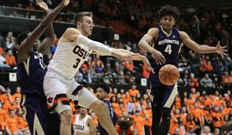 Washington's Matisse Thybulle (4) defends as Oregon State's Tres Tinkle (3) passes the ball during the first half of an NCAA college basketball game in Corvallis, Ore., Saturday, Feb. 10, 2018. (AP Photo/Timothy J. Gonzalez)