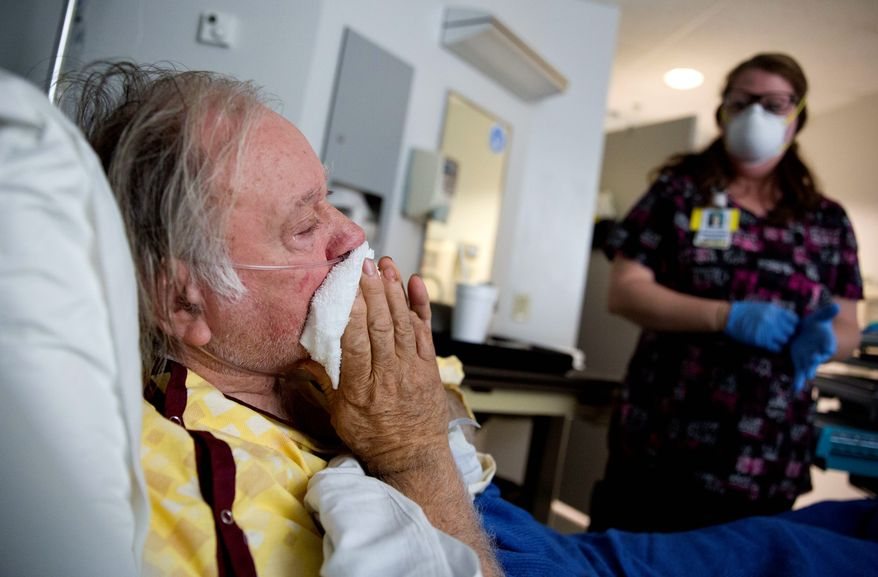 Henry Beverly battles the flu while tended to by nurse Kathleen Burks in a Thomaston, Georgia, hospital. This flu season is the worst since health officials began record keeping in 2004, surpassing the previous worst outbreak of 2014/15. (ASSOCIATED PRESS)