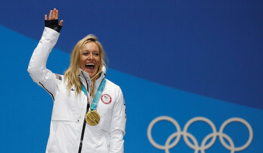 American Jamie Anderson cemented herself as an all-time great by winning and defending her gold medal on Monday in the women's slopestyle at the Winter Olympics in Pyeongchang, South Korea. Anderson won despite overcoming shifting, bitter winds and iced-over jumps at the snow park. Her score of 83 resulted in a blowout of nearly seven points over silver medalist Laurie Blouin of Canada. (ASSOCIATED PRESS PHOTOGRAPHS)