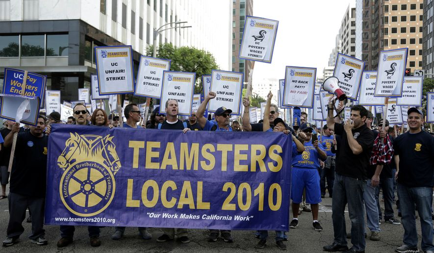 "Several hundred union members wearing Teamsters shirts and hats participate in a rally at the University of California Los Angeles carrying signs reading ""fair contract now!"" and ""UC unfair!"" Wednesday, Nov. 16, 2016, in Los Angeles. Electricians, elevator mechanics, plumbers and other workers at UCLA walked off the job Wednesday to demand higher wages in a daylong strike. No major disruptions were reported. (AP Photo/Nick Ut)"