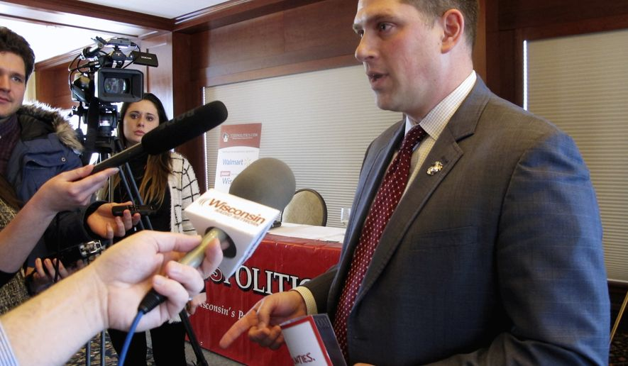FILE - In this Jan. 30, 2018, file photo, Wisconsin Republican Senate candidate Kevin Nicholson speaks with reporters in Madison, Wis. Nicholson faces Republican state Sen. Leah Vukmir in the Republican primary. The winner will face Democratic Sen. Tammy Baldwin in the November election. (AP Photo/Scott Bauer, File)