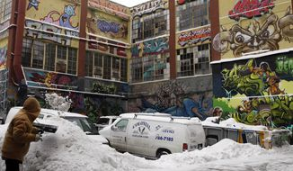 """On Monday, Feb. 12, 2018, a federal judge awarded $6.7 million to graffiti artists who sued after dozens of spray paintings near 5Pointz were destroyed on the walls of the dilapidated warehouse buildings torn down to make room for high-rise luxury residences. U.S. District Judge Frederic Block in Brooklyn said 45 of the 49 paintings were recognized works of art """"wrongfully and willfully destroyed"""" by a remorseless landlord. (AP Photo/Frank Franklin II) ** FILE **"""